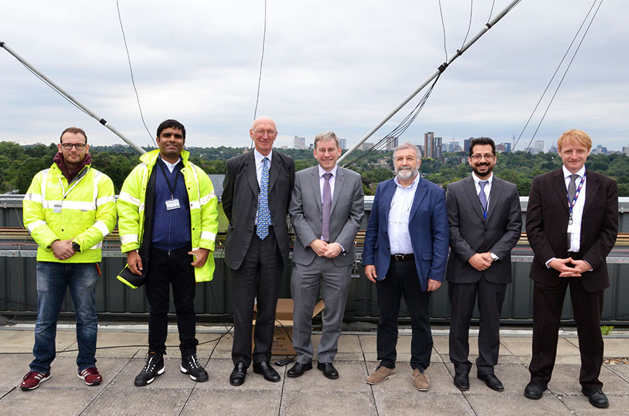 Lord Prior of Brampton with Professor Andy Schofield and mebers of the University of Birmingham SIMITAR project on the roof of Gisbert Kapp
